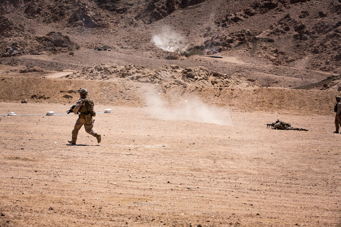 U.S. Marines with weapons platoon, Fox Company, 2nd Battalion, 7th Marine Regiment, Special Purpose Marine Air - Ground Task Force - Crisis Response - Central Command, conduct a movement-to-contact during a live - fire range during Mission Rehearsal Exercise 2016 near the southern border of the Hashemite Kingdom of Jordan,  Sept. 11, 2016. The MRX is a collective training event where the MAGTF elements collaborate to refine individual and cooperative capabilities. SPMAGTF - CR – CC is a self-sustaining expeditionary unit, designed to provide a broad range of crisis response capabilities throughout the Central Command area of responsibility, using organic aviation, logistical, and ground combat assets, to include embassy reinforcement and tactical recovery of aircraft and personnel. (U.S. Marine Corps photo by Cpl. Trever Statz/Released)