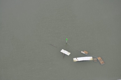Debris is tangled around a navigation aid near Thunderbolt.