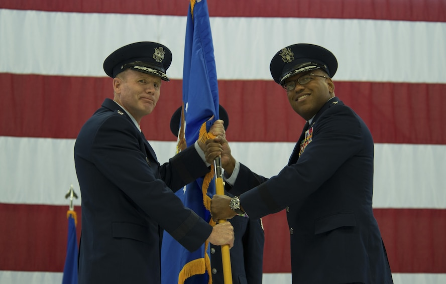 Gen. Tod D. Wolters, U.S. Air Forces in Europe and Air Forces Africa commander, passes the guidon to Lt. Gen. Richard M. Clark, 3rd Air Force commander, during a change of command ceremony at Ramstein Air Base, Germany, Oct. 21, 2016. The passing of the guidon symbolizes the transfer of command. (U.S. Air Force photo by Senior Airman Tryphena Mayhugh)
