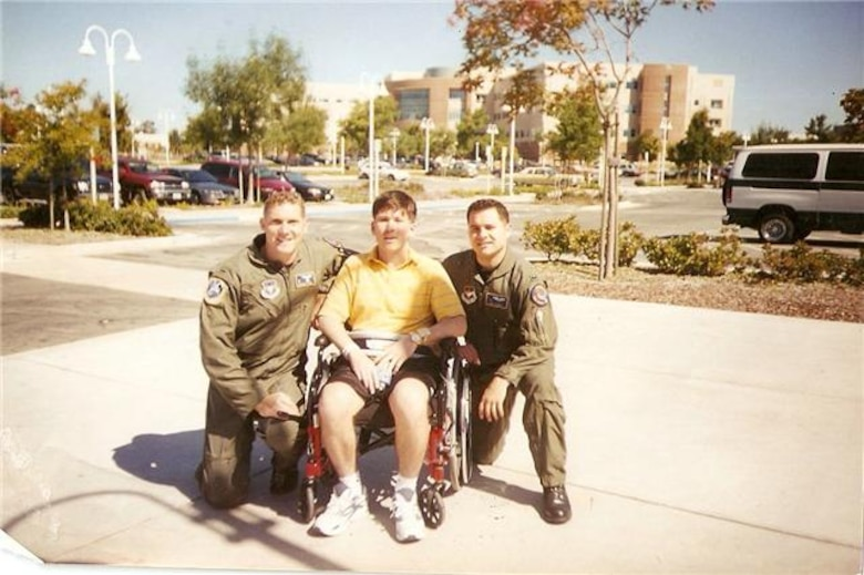 From left to right, Nathan Day, Kevin Ormsby, and Vincent Dana, pose for a photo in Palo Alto, California. Day and Dana, former colleagues of Ormsby, visited him after a skiing accident hospitalized him, and grounded him from flying. (Courtesy Photo)