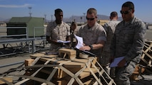 U.S. Marine Corps Lance Cpl. Bryson Leysath, Chief Warrant Officer 2 Robert Hallett and U.S. Air Force Tech. Sgt. Geoffrey Gaeraths inspect pallets containing M-88A2 HERCULES equipment at March Air Force Reserve Base, Calif., Oct. 14, 2016. Leysath, from Augusta, Ga., is an embarkation specialist with Combat Logistics Regiment 15, Hallett, from Mesa, Az., is a mobility officer with CLR 15 and Gaeraths, from Victorville, Calif., is a joint inspector with 452nd Logistics Readiness Squadron.