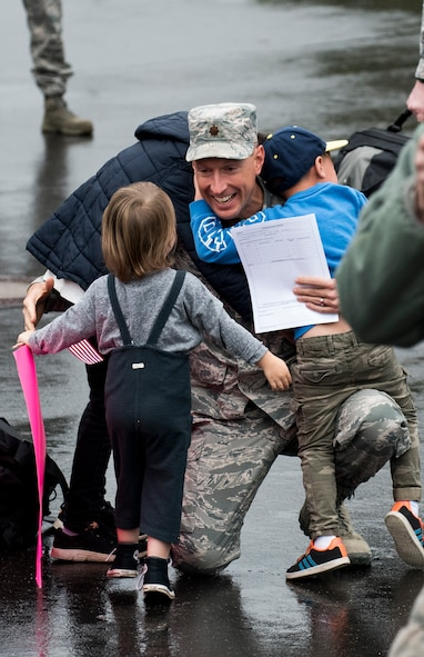 An Airman assigned to the 606th Air Control Squadron greets his children during the squadron's return to Spangdahlem Air Base, Germany, Oct. 20, 2016. The squadron's homecoming takes place in advance of their upcoming relocation from Spangdahlem to Aviano Air Base, Italy, in 2017 as part of the European Infrastructure Consolidation plan. (U.S. Air Force photo by Airman 1st Class Preston Cherry)