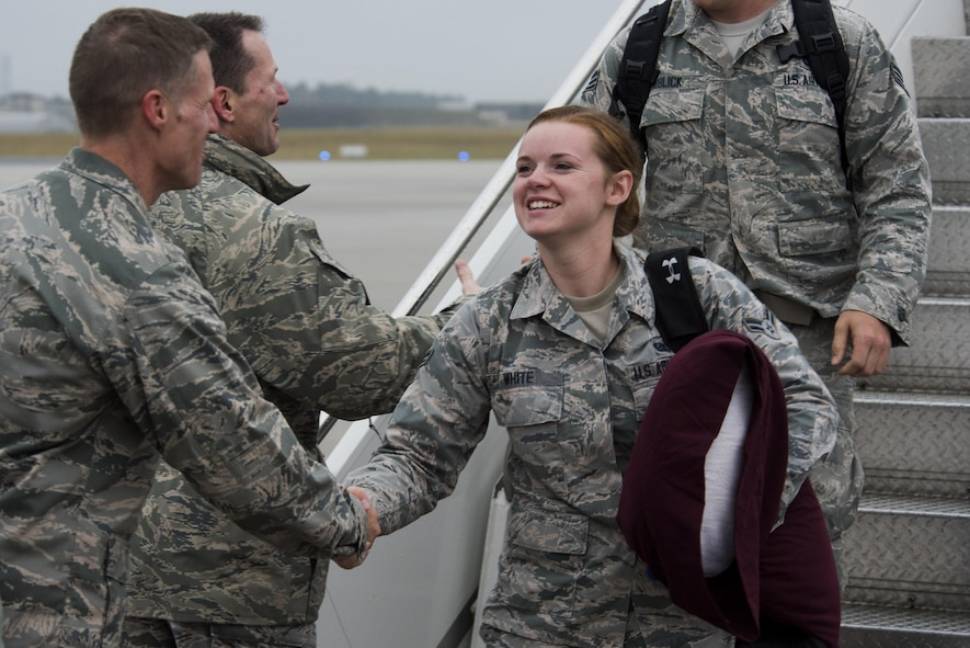 Col. Michael Thompson, 52nd Operations Group commander, left, greets an Airman assigned to the 606th Air Control Squadron upon her return from deployment to their squadron at Spangdahlem Air Base, Germany, Oct. 20, 2016. Nearly 200 Airmen assigned to the 606th ACS returned, from a six-month rotational deployment to Southwest Asia in support of Operations Freedom's Sentinel and Inherent Resolve. (U.S. Air Force photo by Staff Sgt. Joe W. McFadden)