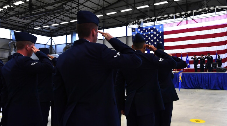 Ramstein Airmen render a salute during the 3rd Air Force change of command at Ramstein Air Base, Germany, Oct. 21, 2016. Members of the 3rd Air Force bade farewell to Lt. Gen. Ray as they welcomed Lt. Gen. Richard M. Clark. (U.S. Air Force photo by Senior Airman Tryphena Mayhugh)