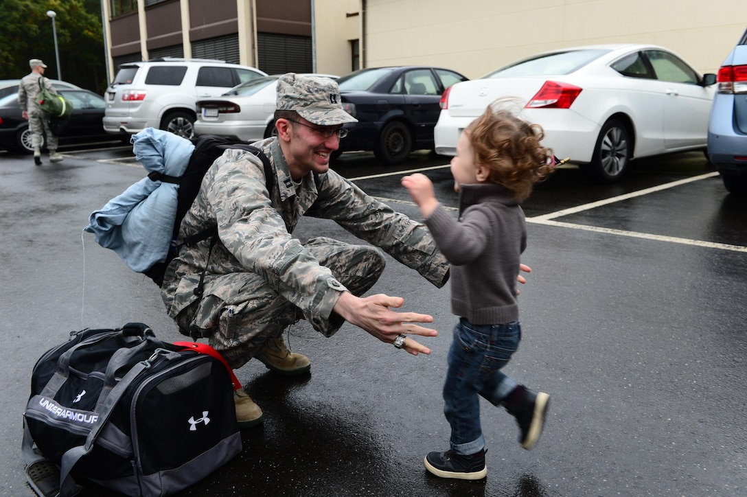 An Airman assigned to the 606th Air Control Squadron embraces his son after his return to Spangdahlem Air Base, Germany, Oct. 20, 2016, from a six-month rotational deployment to Southwest Asia in support of Operations Freedom's Sentinel and Inherent Resolve. The 606th ACS is a self-sustaining squadron consisting of maintenance, supply and approximately 21 other Air Force specialties. (U.S. Air Force photo by Senior Airman Joshua R. M. Dewberry)