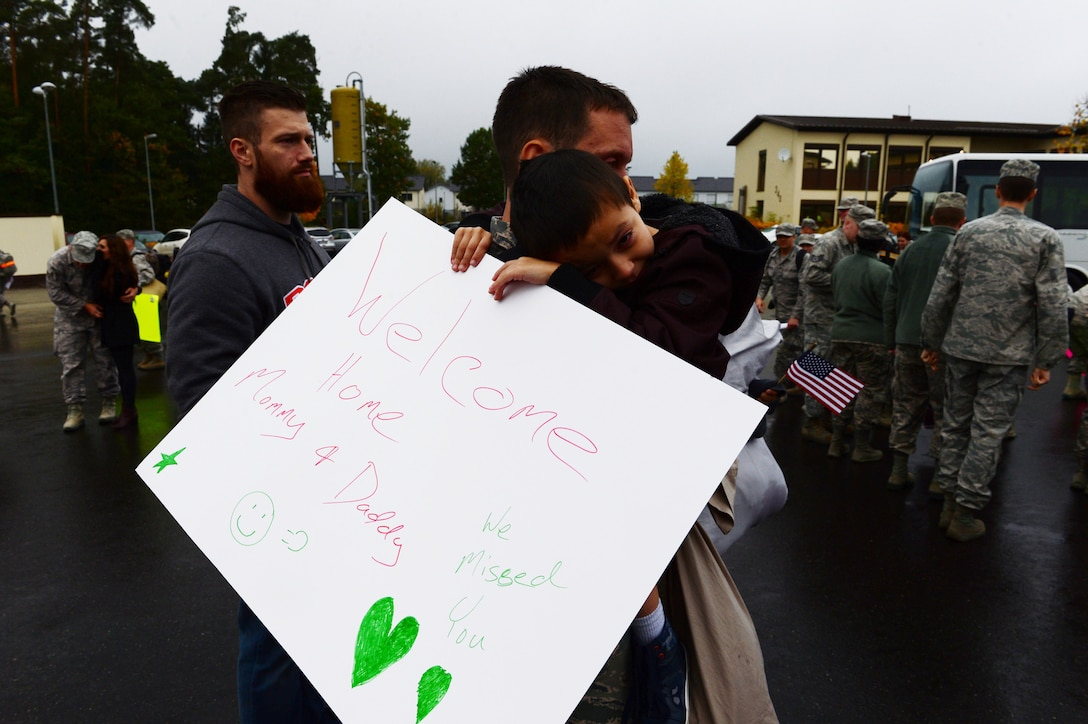 Ayoung boy hugs his father after waiting for his parents, assigned to the 606th Air Control Squadron, to return to Spangdahlem Air Base, Germany, Oct. 20, 2016, from a six-month rotational deployment to Southwest Asia in support of Operations Freedom's Sentinel and Inherent Resolve. The unit provides daily command and control to the 480th Fighter Squadron, in addition to the occasional control of E-3A Sentry AWACS from NATO Air Base Geilenkirchen, Germany, and visiting aircraft from around the U.S. Air Forces in Europe's scope of operations. (U.S. Air Force photo by Senior Airman Joshua R. M. Dewberry)