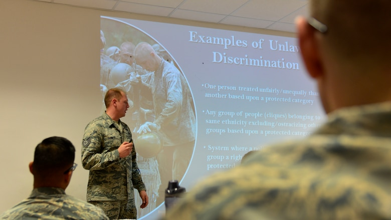Tech. Sgt. Patrick Corbeil, 31st Fighter Wing equal opportunity NCO in-charge, briefs new Team Aviano Airmen on how to prevent workplace discrimination on Oct. 18, 2016 at Aviano Air Base, Italy. EO members educate Team Aviano personnel on appropriate workplace behavior. (U.S. Air Force photo by Senior Airman Cary Smith/Released)
