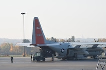 """Airmen load cargo onto an LC-130 """"Skibird"""" with the New York Air National Guard's 109th Airlift Wing on Oct. 18, 2016, shortly before it departed for McMurdo Station, Antarctica. This is the 29th season that the unit will participate in Operation Deep Freeze, the military component of the U.S. Antarctic Program, which is managed by the National Science Foundation. (U.S. Air National Guard photo by Master Sgt. William Gizara/Released)"""