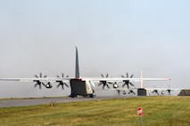 """Two LC-130 """"Skibirds"""" with the New York Air National Guard's 109th Airlift Wing sit on the ramp on Oct. 18, 2016, shortly before departing for McMurdo Station, Antarctica. This is the 29th season that the unit will participate in Operation Deep Freeze, the military component of the U.S. Antarctic Program, which is managed by the National Science Foundation. (U.S. Air National Guard photo by Master Sgt. William Gizara/Released)"""