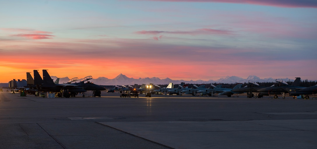 South Korean F-15K Slam Eagles along with U.S. Marine Corps F/A-18C Hornets prepare for a sortie Oct. 11, 2016, during Red Flag-Alaska 17-1 at Eielson Air Force Base, Alaska. Red Flag-Alaska provides unique opportunities to integrate various forces into joint, coalition and multilateral training from simulated forward operating bases. The Hornets are assigned to the Marine Fighter Attack Squadron 232 at Marine Corps Air Station Miramar, Calif. (U.S. Air Force photo/Staff Sgt. Shawn Nickel)