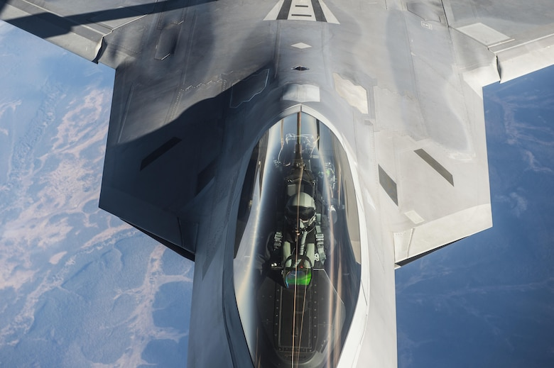 An F-22 Raptor receives fuel from a KC-135 Stratotanker during exercise Vigilant Shield 2017, Oct. 17, 2016. Vigilant Shield is an annual exercise sponsored by the North American Aerospace Defense Command and led by the Alaskan NORAD Region, in conjunction with the Canadian and Continental NORAD Region, who undertake field training exercises aimed at improving operational capability in a bi-national environment. The F-22 is from Joint Base Elmendorf-Richardson, Alaska, and the KC-135 is assigned to the 92nd Aerial Refueling Squadron from Fairchild Air Force Base, Wa. (U.S. Air Force photo/Tech. Sgt. Gregory Brook)