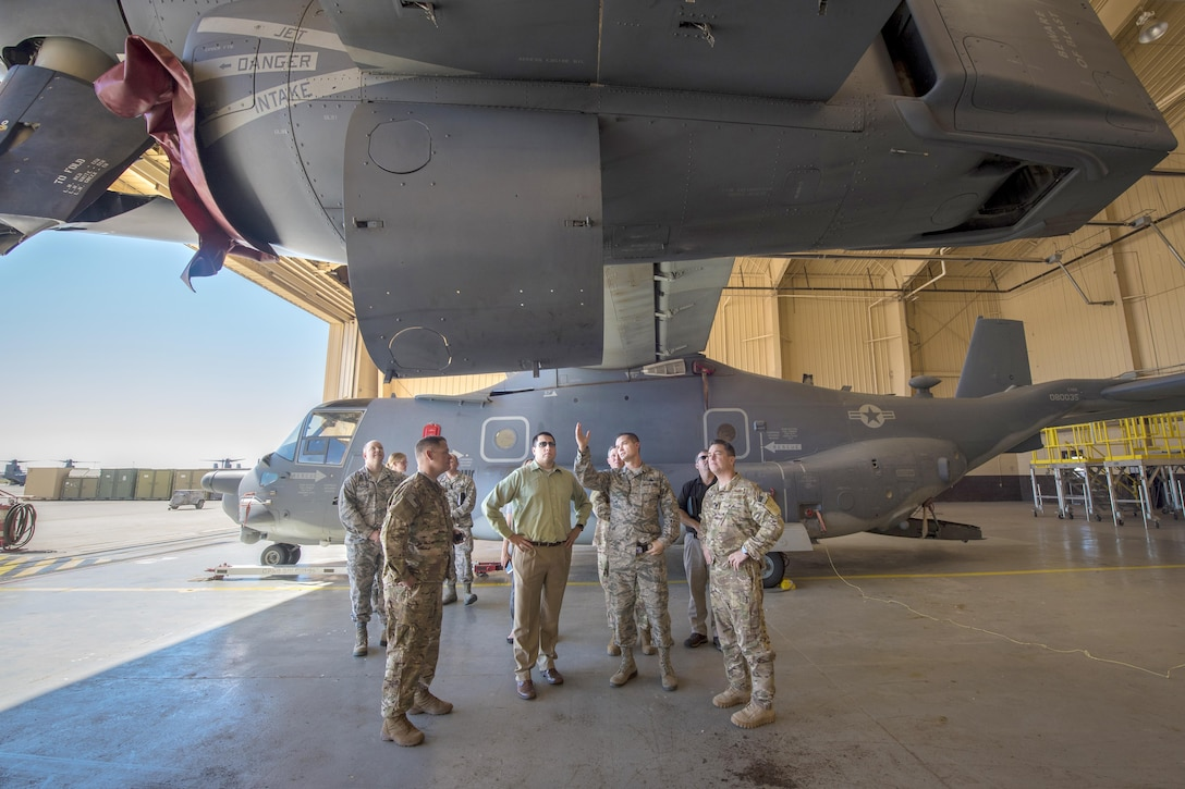 Operators and maintainers of the CV-22 Osprey with the 27th Special Operations Maintenance Group, 727th Special Operations Aircraft Maintenance Squadron and 20th Special Operations Squadron describe the advantages and challenges of the airframe to Tony Samp, military legislative assistant to  Sen. Martin Heinrich, Oct. 11, 2016 at Cannon Air Force Base, N.M. Samp joined Matt Padilla, MLA to Sen. Tom Udall, on a site visit to Cannon for an immersion tour. (U.S. Air Force Photo by Senior Airman Shelby Kay-Fantozzi/released)