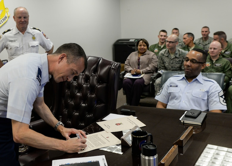 Col. Houston Cantwell, the 49th Wing Commander, signs the Fire Prevention Week proclamation at Holloman Air Force Base, N.M. on Oct. 9, 2016. Holloman Air Force Base's Fire Prevention Week is annually practiced in commemoration of the great Chicago Fire of 1871. Members with the 49th Civil Engineer Squadron Fire Protection Flight performed fire drills, and educated people on proper use of a fire extinguisher and the importance of changing out batteries in smoke alarms every six months. (U.S. Air Force photo by Airman 1st Class Alexis P. Docherty)