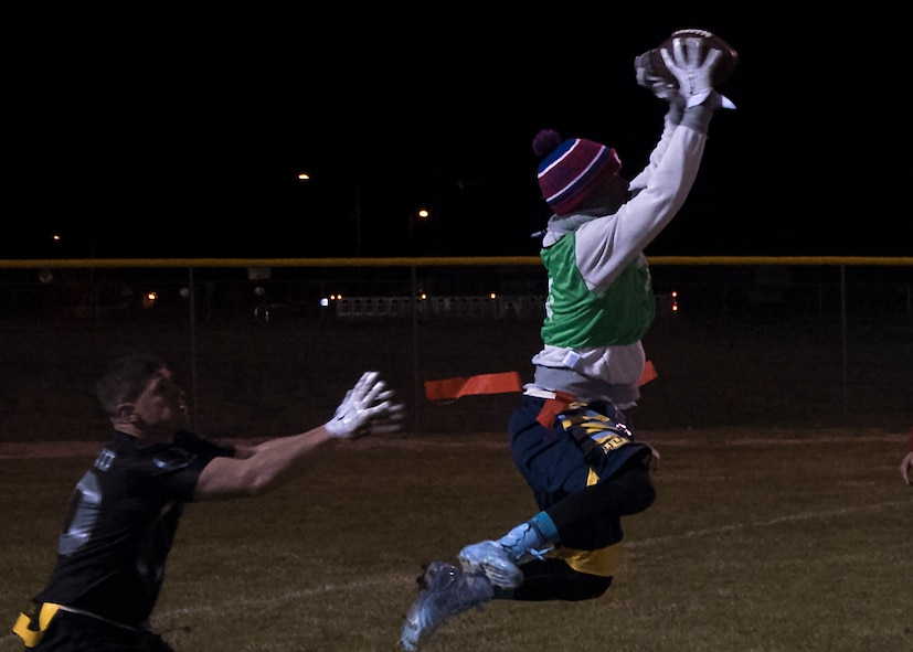 Christopher Marshall, 90th Maintenance group and 20th Air Force intramural flag football team member, catches a pass during the championship game at F.E. Warren Air Force Base, Wyo., Oct. 19, 2016. The playoffs were a double elimination tournament, forcing a second championship game between the two teams. (U.S. Air Force photo by Senior Airman Brandon Valle)