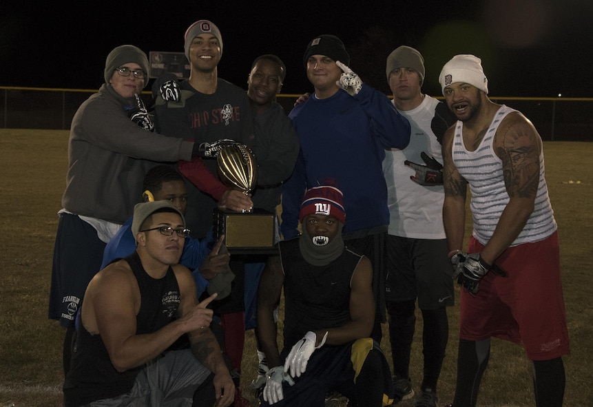 The 90th Maintenance Group and 20th Air Force intramural flag football team pose after winning the championship at F.E. Warren Air Force Base, Wyo., Oct. 19, 2016. The team will keep the trophy until the conclusion of the intramural basketball championship in January. (U.S. Air Force photo by Senior Airman Brandon Valle)
