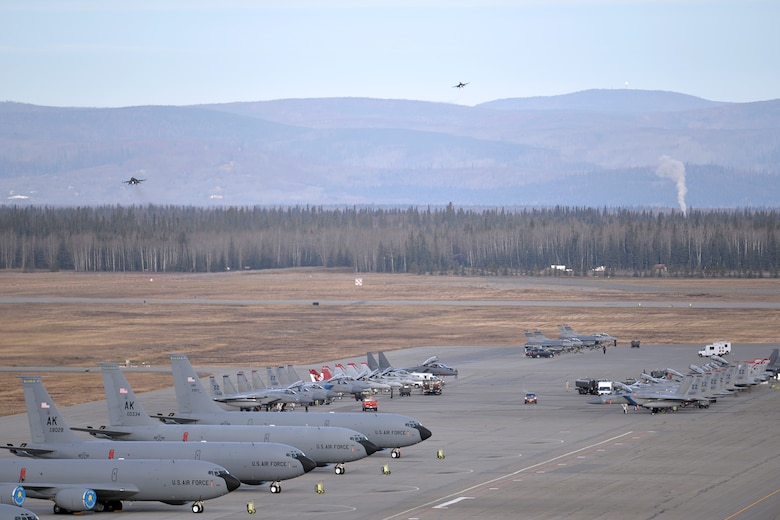 A variety of units aircraft and personnel gather in their ramp space as a pair of F-16 Fighting Falcons prepare to land at Eielson Air Force Base, Alaska, Oct. 10, 2016, after the first Red Flag-Alaska 17-1 combat training mission. Red Flag-Alaska is a Pacific Air Forces commander-directed field training exercise and is vital to maintaining peace and stability in the Indo-Asia-Pacific region. The F-16s are assigned to the 36th Fighter Squadron at Osan Air Base, South Korea. (U.S. Air Force photo/Master Sgt. Karen J. Tomasik)