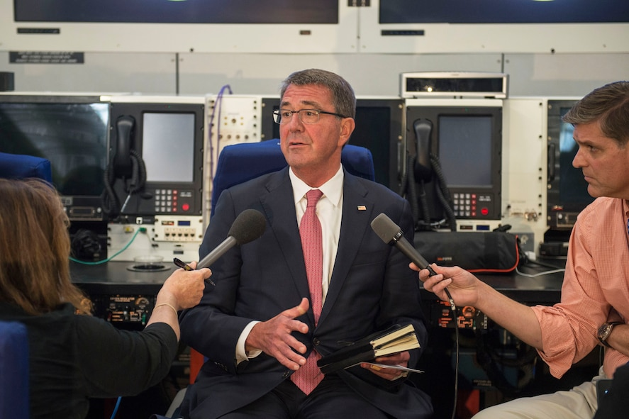 Defense Secretary Ash Carter speaks with reporters while traveling.