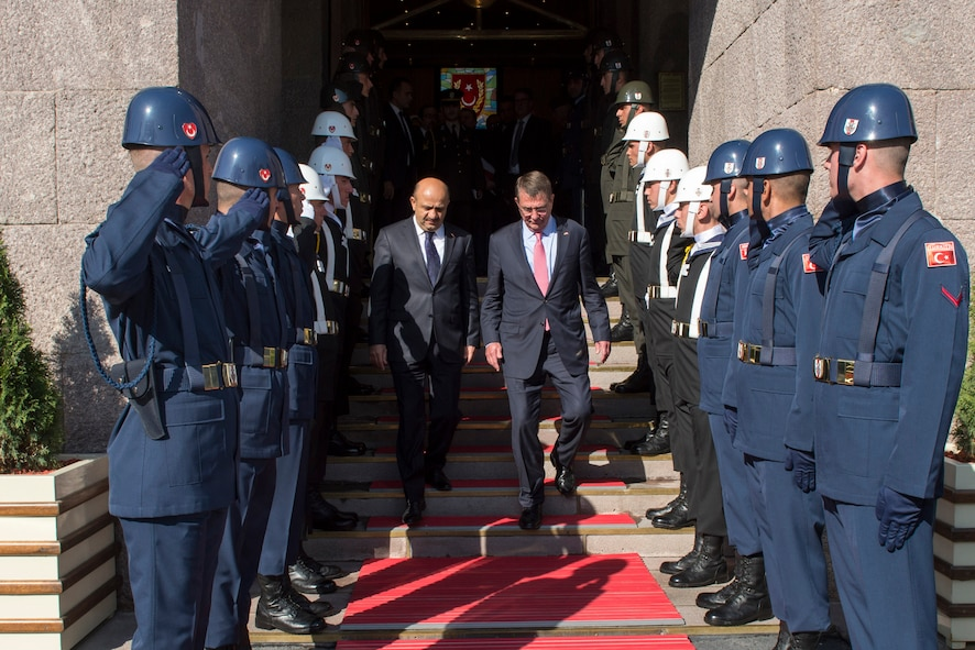 Defense Secretary Ash Carter walks through an honor cordon with Turkish Defense Minister Fikri Işık.