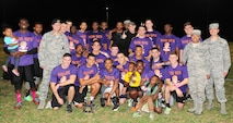 Members of the 509th Security Forces Squadron pose with the intramural flag-football championship trophy at Whiteman Air Force Base, Mo., Oct. 17, 2016. U.S. Air Force Brig. Gen. Paul W. Tibbets IV, the 509th Bomb Wing (BW) commander, and Chief Master Sgt. Melvina Smith, the 509th BW command chief, presented the team with the trophy. (U.S. Air Force photo by Senior Airman Joel Pfiester)