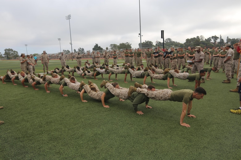 Marines with Marine Aircraft Group (MAG) 39 compete in a team pushup challenge during the Warrior Games Field Meet at Marine Corps Base Camp Pendleton, Calif., Oct. 15. The Warrior Games consisted of a five-month competition between squadrons within MAG-39, culminating in a field meet, where each squadron competed to win points toward a trophy and grand prize of a 72-hour liberty period. (U.S. Marine Corps photo by Lance Cpl. Jacob Pruitt/Released)