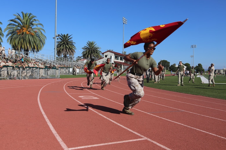 Marines with Marine Aircraft Group (MAG) 39 compete in a guidon race during the Warrior Games Field Meet at Marine Corps Base Camp Pendleton, Calif., Oct. 15. The Warrior Games consisted of a five-month competition between squadrons within MAG-39, culminating in a field meet, where each squadron competed to win points toward a trophy and grand prize of a 72-hour liberty period.(U.S. Marine Corps photo by Lance Cpl. Jacob Pruitt/Released)