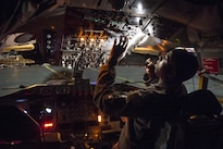 Air Force Capt. Jaamal Neal performs preflight checks at Joint Base Elmendorf-Richardson, Alaska, Oct. 20, 2016, before taking off to provide refueling capabilities to Canadian CF-18s during Vigilant Shield 2017, a  training exercise in the high Arctic. Neal is a KC-135 Stratotanker co-pilot assigned to the 912th Air Refueling Squadron, March Air Force Base, Calif. Air Force photo by Tech. Sgt. Gregory Brook