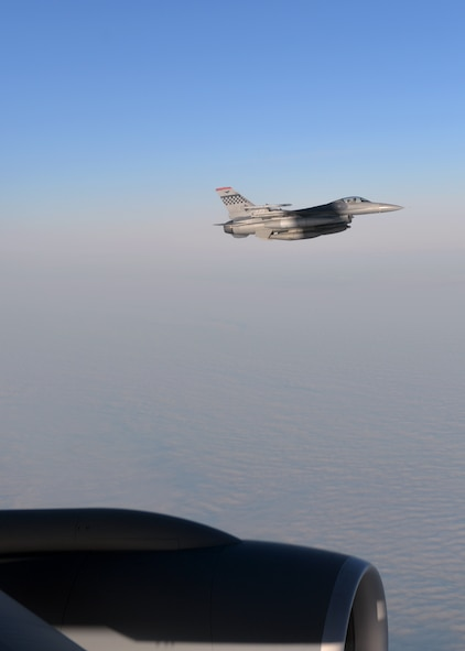 A U.S. Air Force F-16 Fighting Falcon assigned to the 36th Fighter Squadron out of Osan Air Base, Republic of Korea, flies in formation next to a KC-135 Stratotanker out of McConnell Air Force Base, Kan., Oct. 10, 2016, during a RED FLAG-Alaska (RF-A) 17-1 mission. RF-A, a series of Pacific Air Forces commander-directed field training exercises, provides unique opportunities to integrate various into joint, coalition and multilateral training from simulated forward operating bases. (U.S. Air Force photo by Master Sgt. Karen J. Tomasik)