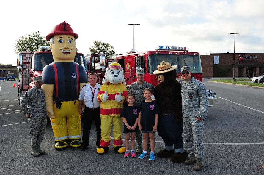 Members of Team Whiteman gather for a group photo prior to the start of the fire prevention finale parade at Whiteman Air Force Base, Mo., Oct. 15, 2016. Fire prevention week is an annual event recognizing fire safety hazards and ways to prevent them from happening. (U.S. Air Force photo by Senior Airman Jovan Banks)