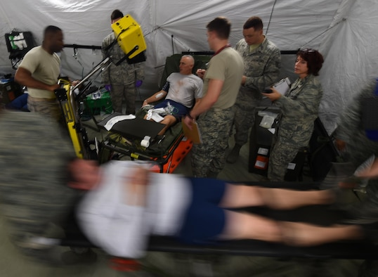 U.S. Air Force Emergency room doctors and technicians treat patients with simulated injuries and illnesses during a medical global response force training exercise at Joint Base Langley-Eustis, Va., Oct. 20, 2016. Members of the medical group put the 25-bed field hospital to the test while treating real-world and simulated patients. (U.S. Air Force photo by Staff Sgt. Natasha Stannard)