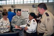 Florida Department of Corrections officers assist an Airman with the job application process during a job fair, Oct. 20, 2016, at Moody Air Force Base, Ga. Organizations ranging from law enforcement agencies to aviation companies were in attendance. (U.S. Air Force photo by Airman 1st Class Greg Nash)