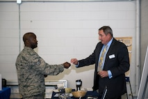 Staff Sgt. Chad Bailey, left, 723d Aircraft Maintenance Squadron combat-oriented supply operator, accepts a business card from Jamie Hopkins, an assistant center manager for a local aviation company, during a job fair, Oct. 20, 2016, at Moody Air Force Base, Ga. The fair was designed for job seekers to establish relationships with employers as they presented their resumes in hopes of getting hired on the spot or being considered for additional interviews. (U.S. Air Force photo by Airman 1st Class Greg Nash)
