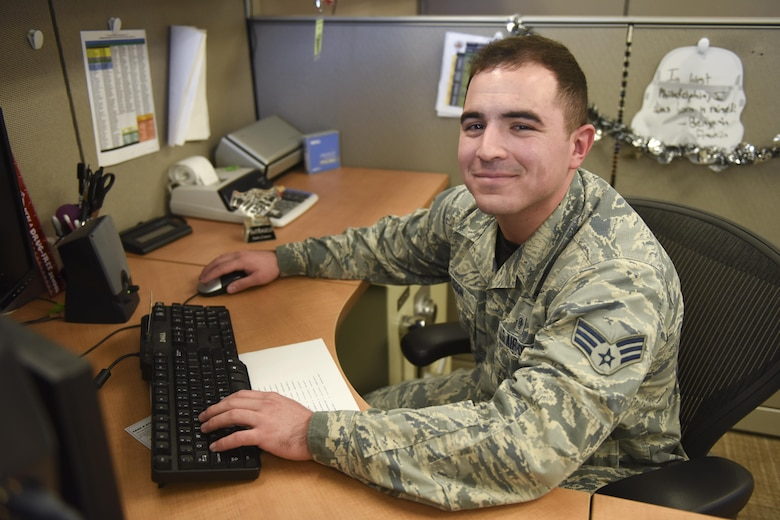 U.S. Air Force Senior Airman Stephen Muldoon, 17th Medical Support Squadron resource management office technician, sits at his desk at the Medical Administration Building on Goodfellow Air Force Base, Oct. 21, 2016. Muldoon was awarded the Phil Neighbors Community Impact Award for his outstanding contributions to the community. (U.S. Air Force photo by Airman 1st Class Chase Sousa/Released)