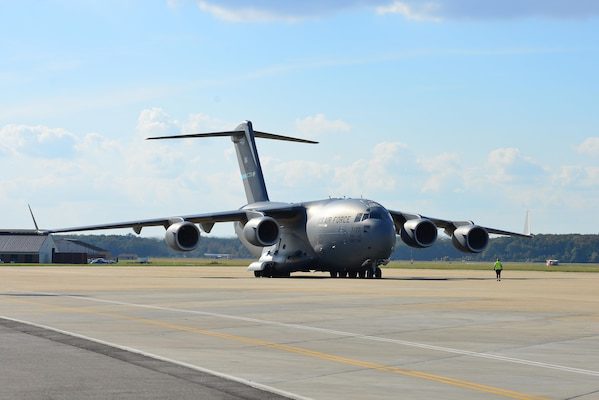 A U.S. Air Force C-17 Globemaster III brings about 20 members of the 689th Rapid Port Opening Element home from Haiti at Joint Base Langley-Eustis, Va., Oct. 20, 2016. The RPOEs are the U.S. Army's main component for both the Seaport of Debarkation and Airport of Debarkation of the United States Transportation Command's Joint Task Force-Port Openings mission. (U.S. Air Force photo by Airman 1st Class Tristan Biese)