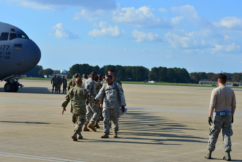 U.S. Army Soldiers from Fort Eustis welcome home members of the 689th Rapid Port Opening Element from Haiti at Joint Base Langley-Eustis, Va., Oct. 20, 2016. The unit provided disaster relief/humanitarian assistance efforts for two weeks, as a result of Hurricane Matthew. (U.S. Air Force photo by Airman 1st Class Tristan Biese)