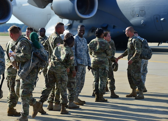 U.S. Army Soldiers from Fort Eustis greet members of the 689th Rapid Port Opening Element after returning from Haiti at Joint Base Langley-Eustis, Va., Oct. 20, 2016. The 689th RPOE worked with members of the 621st Contingency Response Wing, Defense Logistics Agency and other Department of Defense assets as part of a joint task force in a massive effort to receive and sort supplies for those in need as a result of Hurricane Matthew. (U.S. Air Force photo by Airman 1st Class Tristan Biese)