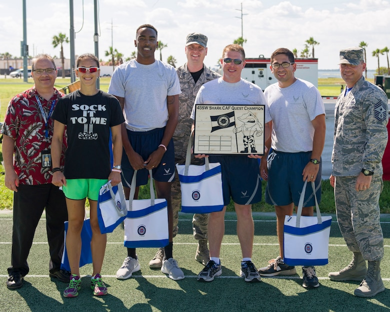 Members of the 45th Operations Group pose for a photo during the Wingman Multicultural Day, Oct. 21, 2016, at Patrick Air Force Base, Fla. The 45th Operations Group won the title of the 2016 Comprehensive Airman Fitness Challenge. The second place winner is the 45th Launch Group; third place winner is the 45th Medical Group; and the fourth places winner is the 45th Mission Support Group. (U.S. Air Force photo/Matthew Jurgens)