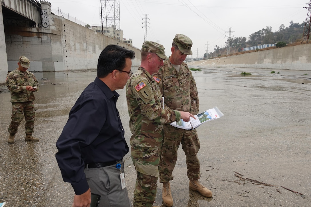 U.S. Army Corps of Engineers South Pacific Division Commander Col. Pete Helmlinger visited various project sites during his week-long visit to the Los Angeles District. Here, District Commander Col. Kirk Gibbs (center) briefs the complexity of the Los Angeles River Ecosystem Restoration as they stand in the river where it's joined by the Arroyo Seco Confluence Oct. 12.