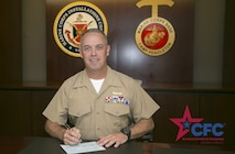 Brig. Gen. Kevin J. Killea, Commanding General, Marine Corps Installations - West, signs a Combined Federal Campaign contribution form in support of the 2016 CFC, Oct. 21. The Combined Federal Campaign is an annual charity campaign designed to assist federal employees that wish to donate to nonprofit organizations around the world.