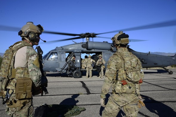 Pararescuemen assigned to the 48th Rescue Squadron load gear on an HH-60G Pave Hawk in preparation for alternate insertion/extraction training at Davis-Monthan Air Force Base, Ariz., Oct. 18, 2016.  The 48th RQS deploys worldwide in support of national security objectives and homeland defense, providing highly trained experts capable of quickly and effectively executing personnel recovery operations. (U.S. Air Force photo by Senior Airman Betty R. Chevalier)