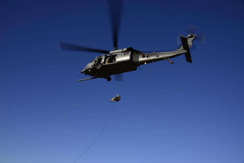 A pararescueman assigned to the 48th Rescue Squadron rappels out of an HH-60G Pave Hawk during alternate insertion/extraction training at Davis-Monthan Air Force Base, Ariz., Oct. 18, 2016.  The four methods that can be used during AIE are fast-rope, rope ladder, rappel and hoist. (U.S. Air Force photo by Senior Airman Betty R. Chevalier)