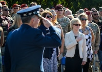 Dawn Goldfein, wife of Air Force Chief of Staff David L. Goldfein, places her hand over her heart as the national anthem is performed during the Special Tactics Memorial dedication ceremony at Hurlburt Field, Fla., Oct. 20, 2016. During her visit, Dawn also met with AFSOC spouses, Airman and Family Readiness Center personnel, and received a Preservation of the Force and Family presentation. (U.S. Air Force photo by Senior Airman Andrea Posey)
