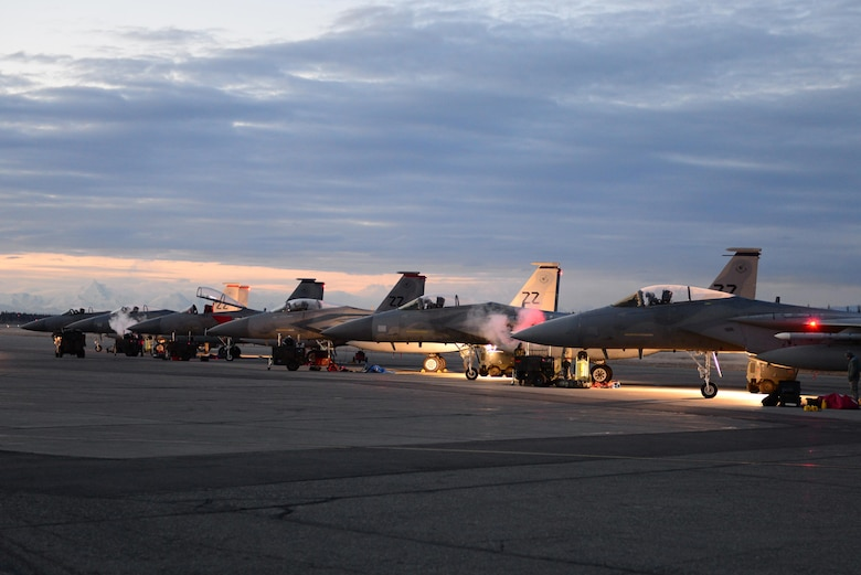 U.S. Air Force Airmen prepare several F-15C Eagle fighter aircraft assigned to the 44th Fighter Squadron out of Kadena Air Base, Japan, Oct. 20, 2016, during RED FLAG-Alaska (RF-A) 17-1, at Eielson Air Force Base, Alaska. RF-A provides training for deployed maintenance and support personnel in sustainment of large-force deployed air operations. (U.S. Air Force photo by Airman Eric M. Fisher)