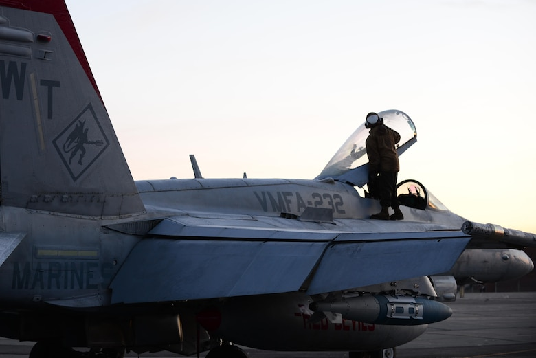 A U.S. Marine assigned to Marine Fighter Attack Squadron 232 out of Marine Corps Air Station, Miramar, Calif., clears ice off the canopy of an F/A-18C Hornet aircraft from the same squadron, Oct. 20, 2016, during RED FLAG-Alaska (RF-A) 17-1, at Eielson Air Force Base, Alaska. RF-A exercises are vital to maintaining peace and stability in the Indo-Asia-Pacific region. (U.S. Air Force photo by Airman Eric M. Fisher)
