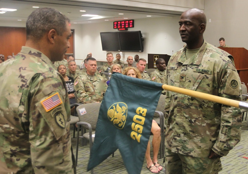 Lt. Gen. Michael Garrett (left), U.S. Army Central commanding general, and Col. Oscar Doward Jr.(right), commander of 2503rd Digital Liaison Detachment, uncase the 2503rd DLD colors during an activation and assumption of command ceremony Oct. 21, 2016, at Patton Hall on Shaw Air Force Base, S.C.