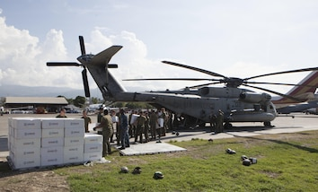 U.S. Marines with Special Purpose Marine Air-Ground Task Force-Southern Command deployed in support of Joint Task Force Matthew, load boxes from United States Agency of International Development aboard a CH-53E Super Stallion helicopter in preparation to deliver the supplies to locals affected by Hurricane Matthew at Port-au-Prince, Haiti, Oct. 10, 2016. . The supply drop operations of JTF Matthew delivered bags of rice, cooking oil and other supplies utilizing CH-53E Super Stallion and CH-47 Chinook helicopters. JTF Matthew, a U.S. Southern Command-directed team, is comprised of Marines with Special Purpose Marine Air-Ground Task Force – Southern Command and soldiers from Joint Task Force-Bravo's 1st Battalion, 228th Aviation Regiment deployed to Port-au-Prince at the request of the Government of Haiti on a mission to provide humanitarian and disaster relief assistance in the aftermath of Hurricane Matthew.