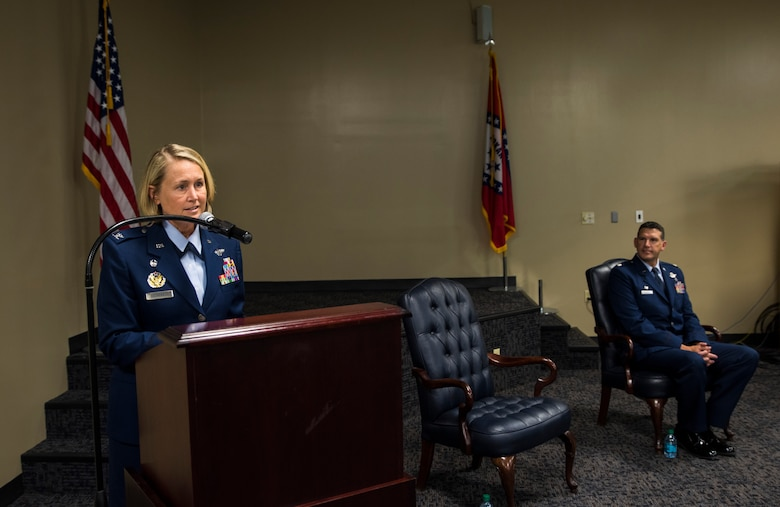 Col. Bobbi Doorenbos, 188th Wing commander, describes the poise and demeanor of Col. Leon Dodroe, 188th Operations Group commander, Oct. 16, 2016, during Dodroe's promotion ceremony at Ebbing Air National Guard Base, Fort Smith, Ark. Dodroe later spoke highly of Doorenbos and how he felt he blossomed under her leadership when they both served in the Arizona Air National Guard. (U.S. Air National Guard photo by Senior Airman Cody Martin)