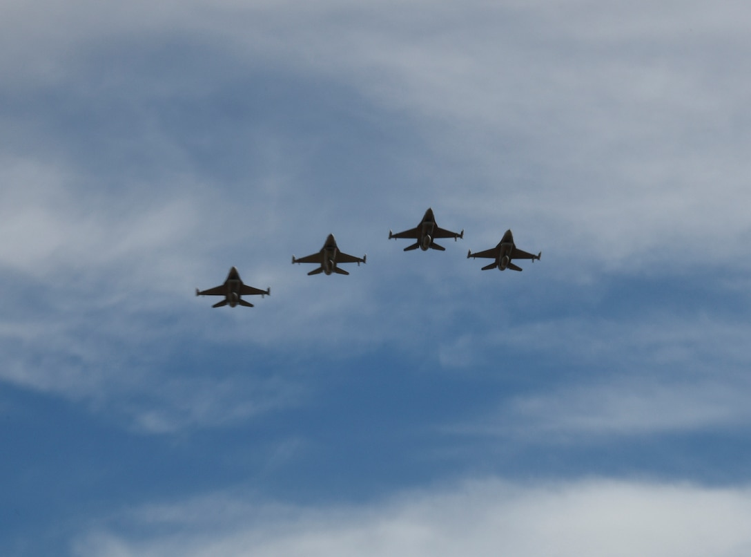 MILLER, S.D. - F-16s of the South Dakota Air National Guard do a missing man formation flyby during the funeral to repatriate fallen World War II U.S. Air Force pilot, 1st Lt. Ben Barnes at the GAR cemetery in Miller, S.D. Oct. 15, 2016.  The unit participates in flyby and flyovers when requested and designated by higher headquarters.(U.S. Air National Guard photo by Senior Master Sgt. Nancy Ausland/Released)