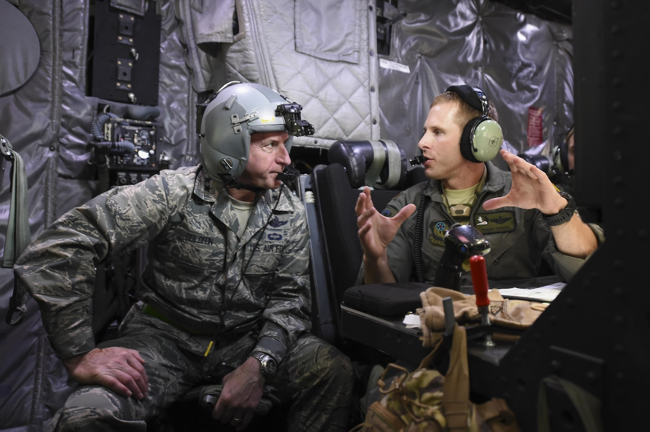 Maj. Travis Tucker, fire control officer with the 4th Special Operations Squadron, explains an AC-130U Spooky gunship's weapons systems to Air Force Chief of Staff Gen. David L. Goldfein during Spooky mission orientation flight at Hurlburt Field, Fla., Oct. 19, 2016. Goldfein was the keynote speaker at the Special Tactics Memorial dedication ceremony at the Hurlburt Field Air Park. During their visit, Goldfein and his wife, Dawn, met with AFSOC, 505th Command and Control Wing, and base leadership and personnel. (U.S. Air Force photo by Senior Airman Jeff Parkinson)