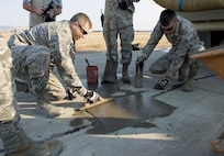 Airmen assigned to the 60th Air Mobility Wing complete a concrete taxiway repair at Travis Air Force Base, Calif., Aug. 19, 2016, 1st Expeditionary Civil Engineer Group airmen recently used similar techniques on a much larger scale to repair damage caused by Islamic State of Iraq and the Levant terrorists at Qayyarah West Airbase in northern Iraq's Ninawa province. Air Force Photo by Heide Couch