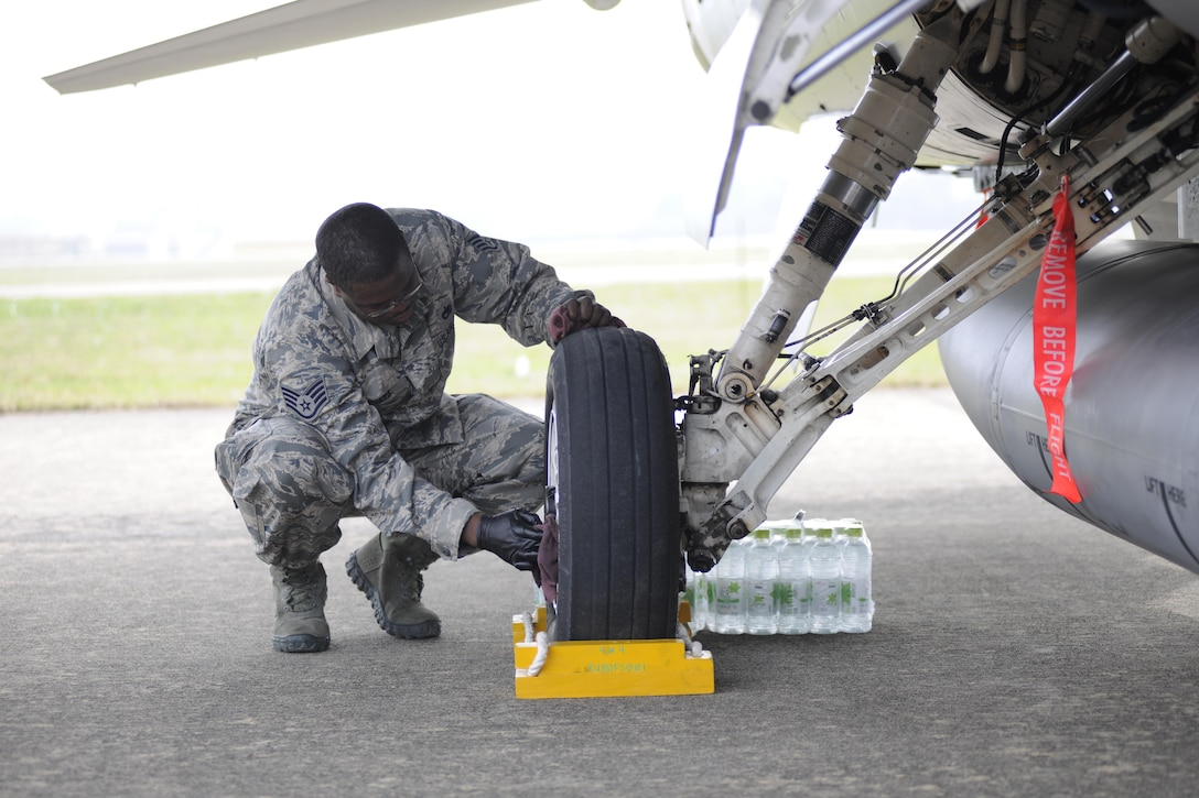 Staff Sgt. Joseph Withers, 8th Aircraft Maintenance Squadron crew chief, cleans the wheel of an F-16 Fighting Falcon at the Sacheon Airshow at Sacheon Base, Republic of Korea, Oct. 20, 2016. 7th Air Force provided both an F-16 and A-10 Thunderbolt II static display for the four-day airshow, showcasing U.S. Air Force capabilities to over 260,000 attendees. (U.S. Air Force photo by 1st Lt. Lauren Linscott/Released)